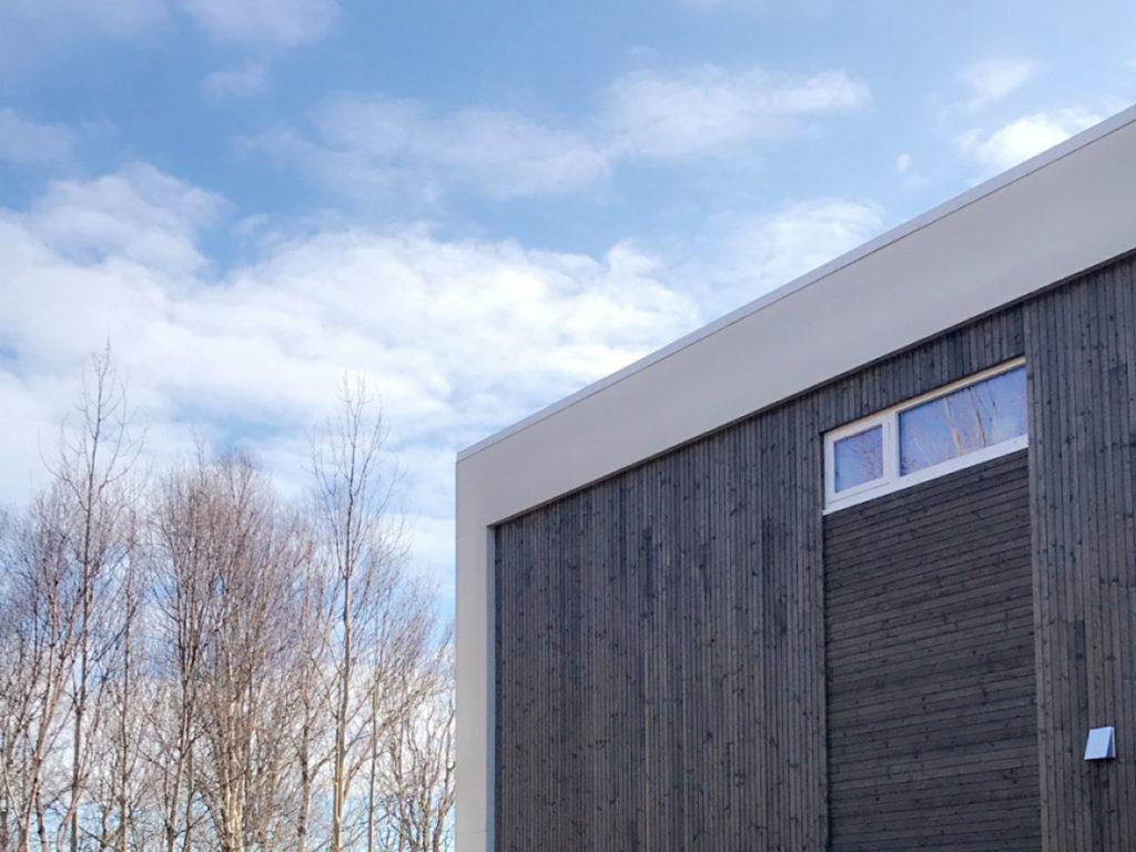 Detaljbilde av fasade med NORD-kledning. Finalist nummer 4 i eksteriørprisen 2021.