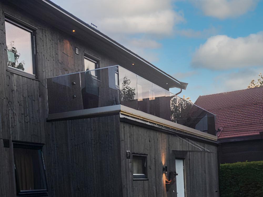 Bilde av hus hos finalist nummer 1 i årets eksteriøpris. NORD-kledning fra Bergene Holm.